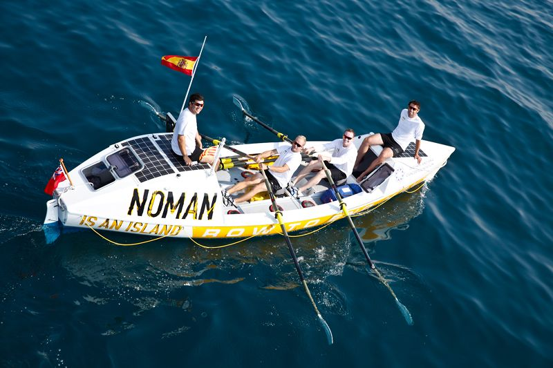 Example of an ocean rowing boat and team, complete with opportunities to display corporate logo. This is the Noman team using their row to raise funds to prevent HPV cancer.